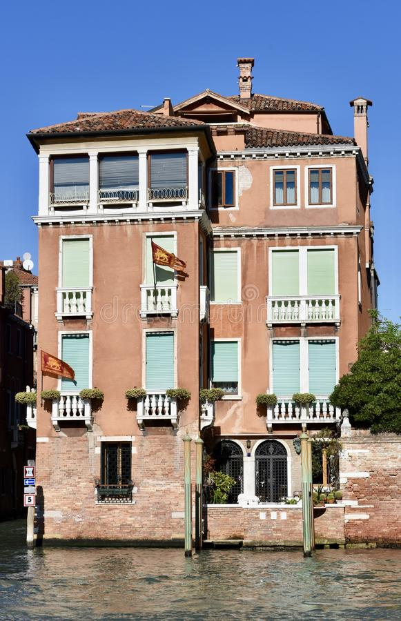 Grand Canal Italianate Palazzo. This is a Fall picture of a four story palazzo is located on the Grand Canal in Venice, Italy. This four story 19th Century brick stock photos