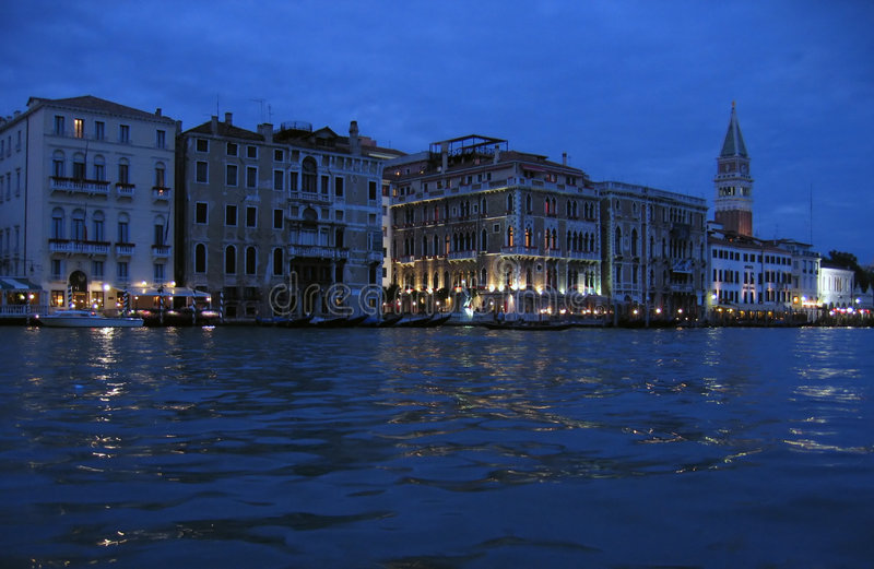 The Grand Canal at night – Venice, Italy. The Grand Canal is the principal waterway of Venice. Its origins are probably natural, one of the many riverbeds royalty free stock photo