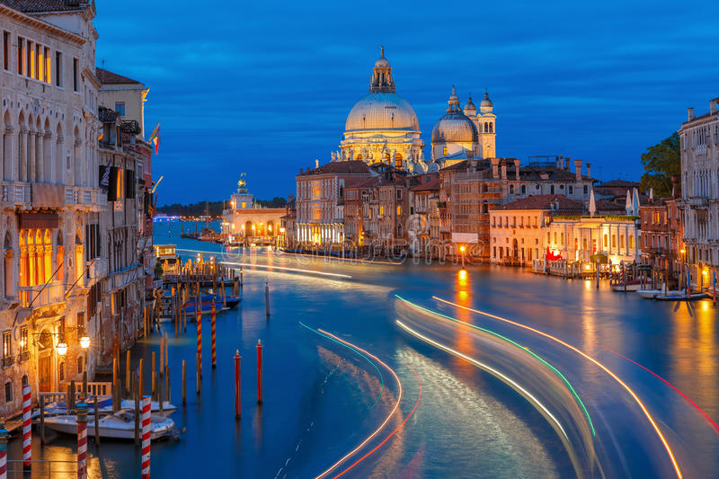 Grand canal at night in Venice, Italy. Grand canal and The Basilica of St Mary of Health or Basilica di Santa Maria della Salute at night in Venice, Italy royalty free stock photography