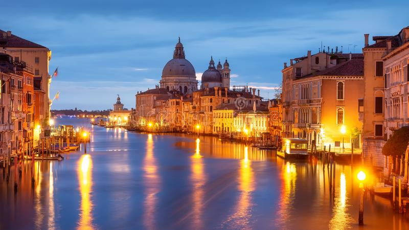 Grand Canal at night, Venice. Santa Maria della Salute church at night city lights, Italy. Venice cityscape illuminated by city stock photos