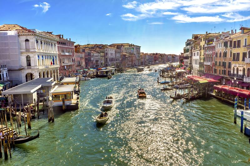 Grand Canal Public Water Ferry Vaporettor Gondolas Venice Italy. Colorful Grand Canal Public Ferries Vaporetto Ferry Docks Gondolas From Rialto Bridge Touirists royalty free stock photography