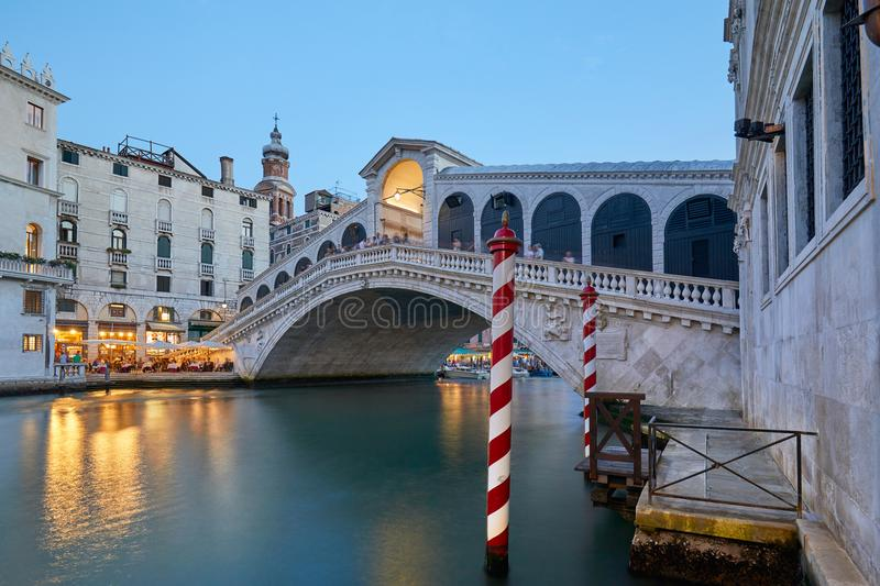 The Grand Canal and Rialto bridge with people, evening in Venice. Italy stock image