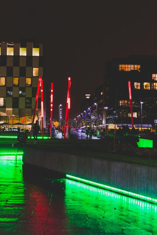 Grand Canal Square by night in the renovated Docklands area. DUBLIN, IRELAND - December 20th, 2017: Grand Canal Square by night in the renovated Docklands area stock photo