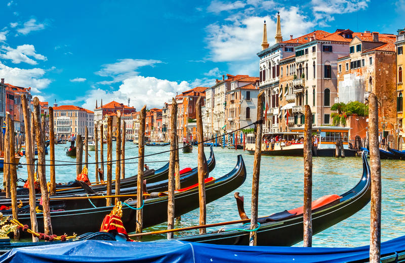 Grand canal in Venice with gondola boat. Blue sky and white cloud picturesque landscape Italy stock photos
