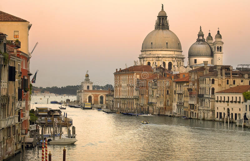Grand Canal - Venice - Italy. The church of Santa Maria della Salute at dusk viewed from the bridge over the Grand Canal at Academia in the city of Venice in royalty free stock photography
