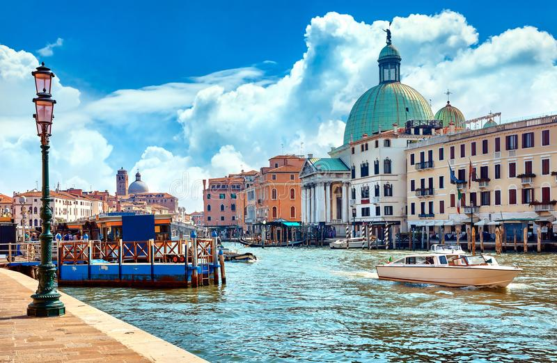 Grand Canal in Venice Italy panoramic view. Grand Canal in Venice Italy. Panoramic view to picturesque landscape city and cathedral San Simeone Piccolo. Boat stock photos