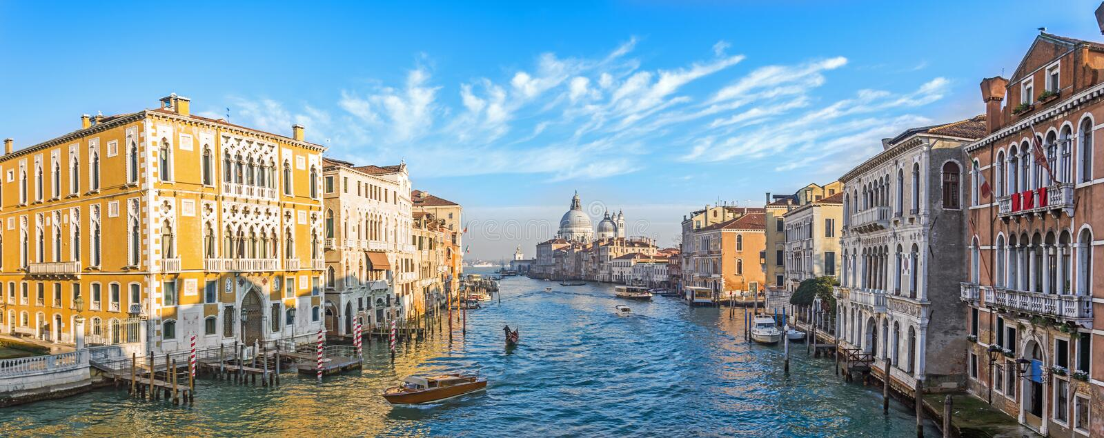 Grand Canal in Venice, Italy. Wide view of the main street panorama of the major street of Venice with motor boats with beautiful stock images