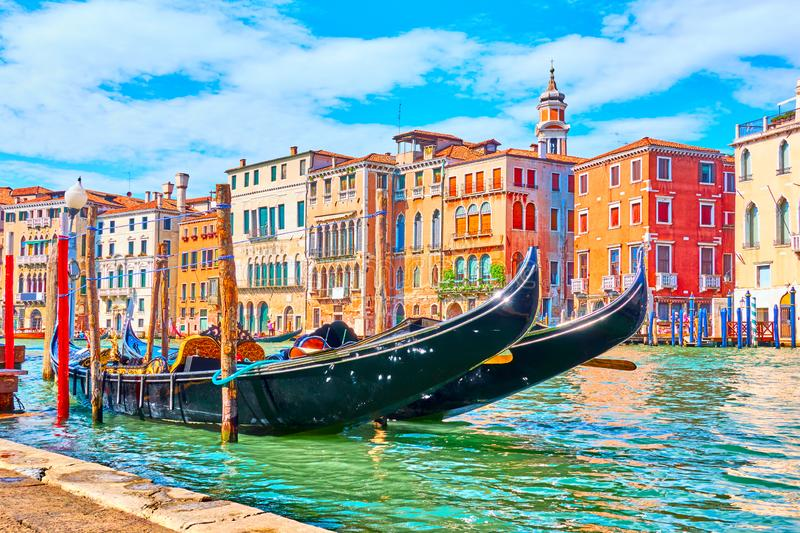 Grand Canal in Venice. The Grand Canal in Venice with moored gondolas on a summer sunny day, Italy royalty free stock photography