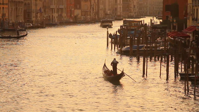 Grand Canal in Venice at sunset. Gondolier with gondola and motor boat on Grand Canal in Venice, Italy during sunset stock video footage