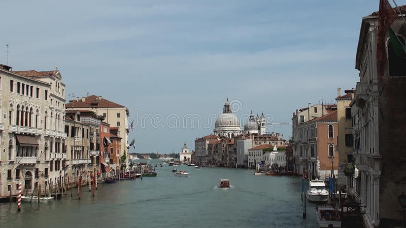 Grand Canal, Venice. View from the Grand Canal Venice with the Sante Maria della Salute church in the distance stock video footage