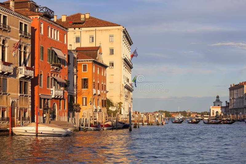 Grand Canal, vintage buildings, parked boats at the marina, Venice, Italy royalty free stock image