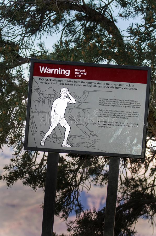 Grand Canyon hikers warning sign about heat exhaustion. Warning sign on the South Kaibab Trail in Grand Canyon National Park. Do not attempt to hike from the royalty free stock photo