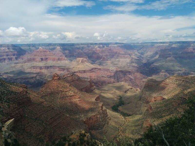Grand Canyon -landschap met wolken en schaduwen stock afbeeldingen