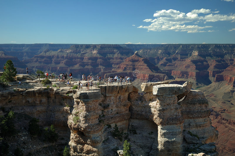 Grand Canyon Overlook. Tourists on an overlook at Grand Canyon National Park stock photo