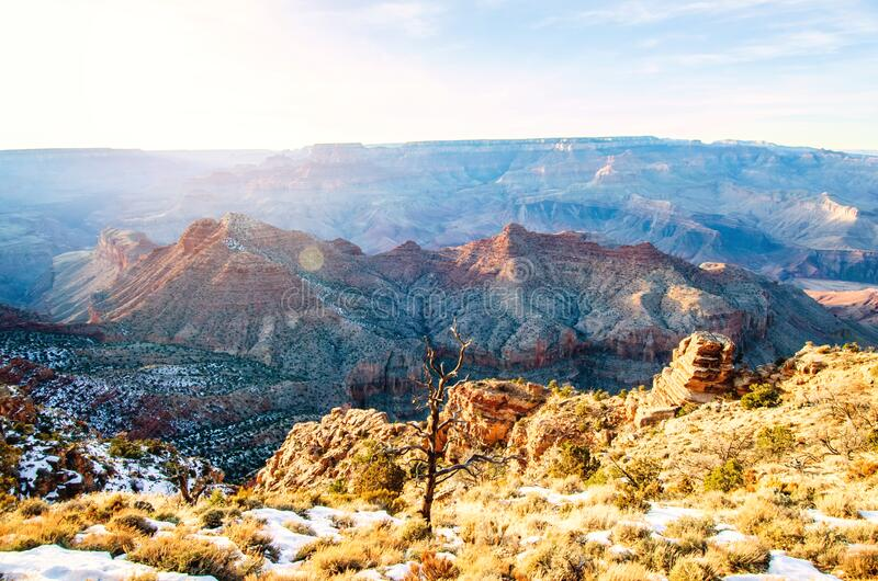 Grand canyon sunset view in winter with snow from Desert view watchtower along south rim stock photo