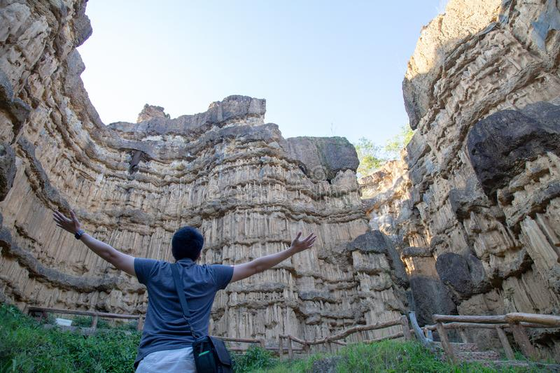 Grand canyon in Thailand, Asia. Pha Chor Canyon, in national park, Chiang Mai Province, Thailand - November 2018 : Happy Man handover to Phachor in Doi Lo Grand stock photo
