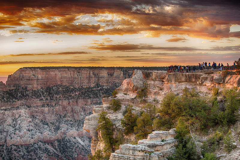 Grand Canyon. Tourist overlooking the Grand Canyon at sunset royalty free stock image