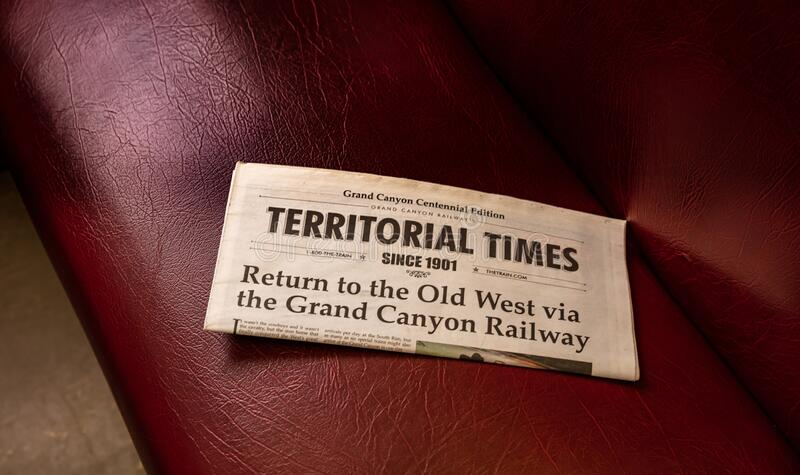 Grand Canyon train, US. Old newspaper named Territorial Times. Red leather background stock photography