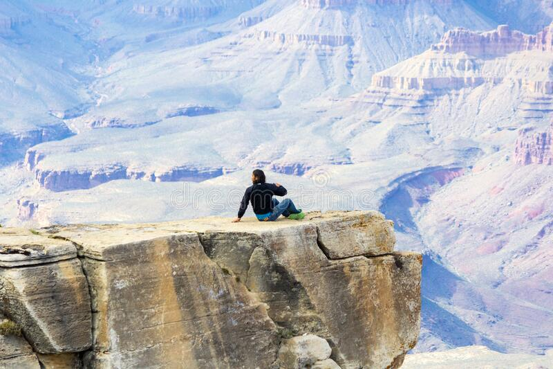 Grand Canyon visitor in precarious position stock photo