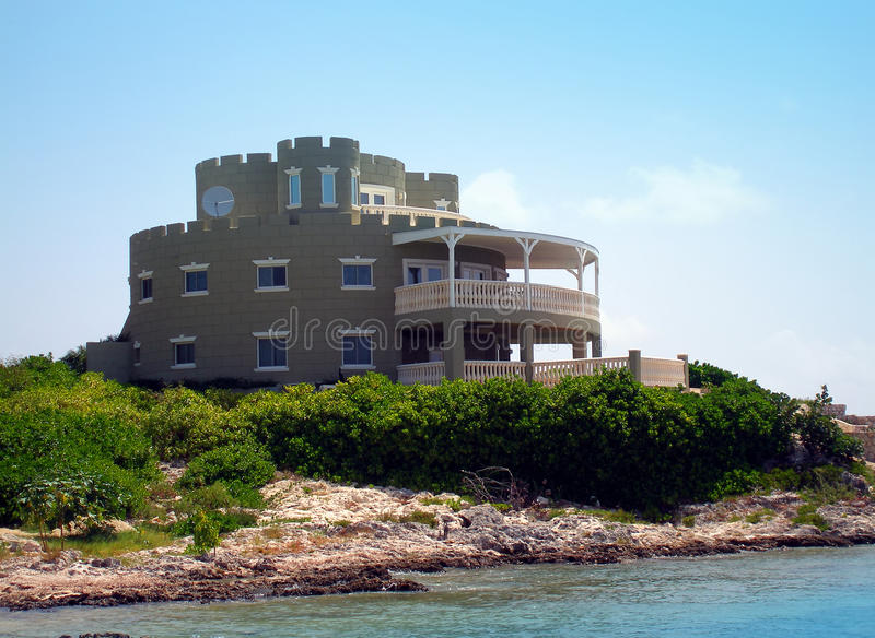 Grand castle style home on Grand Cayman. Grand and imposing beachfront castle style home on the Caribbean island of Grand Cayman. This unique home features stock photography