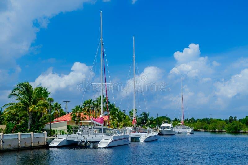 Red Sail Sports Catamaran. Grand Cayman, Cayman Islands, Sept 2018, Red Sail Sports catamarans moor on the Caribbean Sea by the company office stock photo