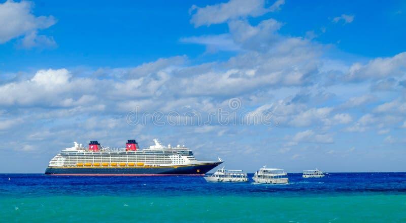 Disney Fantasy Cruise Ship. Grand Cayman, Cayman Islands, cruise ship Disney Fantasy with marine shuttles on the Caribbean Sea near George Town port royalty free stock photo