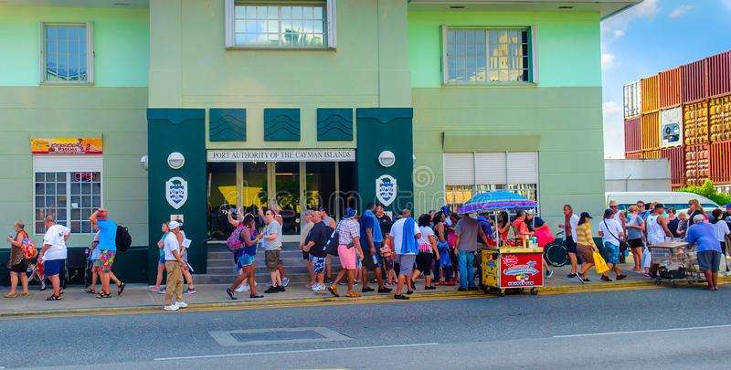 Grand Cayman Holidaymakers. Grand Cayman, Cayman Islands, Feb 2018, tourists at George Town port in the Caribbean, queuing to re-embark on their cruise ship royalty free stock image