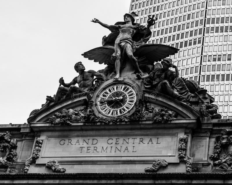 Grand Central Station, Manhattan, NYC, NY. The famous clock and statues on the top of the Grand Central Terminal in Manhattan, NYC royalty free stock images