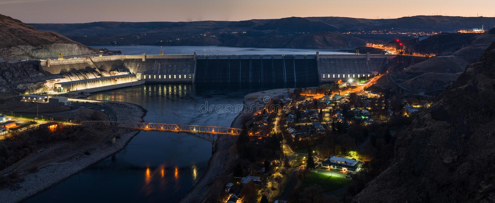 Grand Coulee Dam. This is Grand Coulee Dam in all it`s evening glory. I chose to take this photo during the subtle blue hour. The lights below are the town of stock images