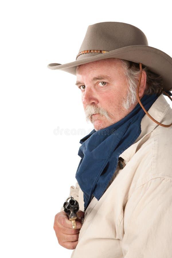 Grand cowboy avec le pistolet sur le fond blanc photo libre de droits