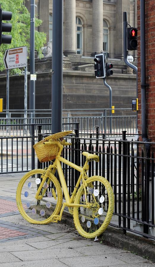 Grand Depart Yellow Bike. Leeds, Yorkshire, June 23rd 2014, City centre prepares for the Tour De France by decorating the cycle race route with yellow bikes stock photos