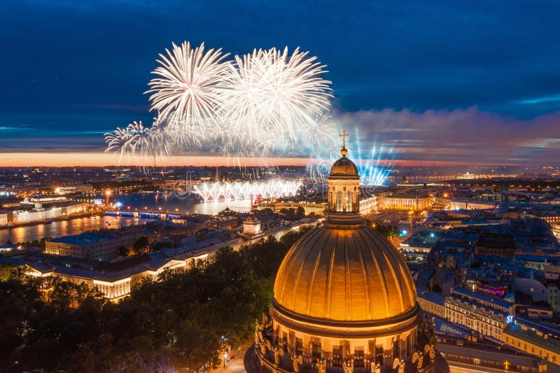 Grand fireworks over the waters of the Neva River in St. Petersburg, see St. Isaac`s Cathedral, the Admiralty, the Palace Bridge, royalty free stock images
