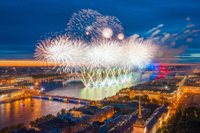 Grand fireworks over the waters of the Neva River in St. Petersburg, visible Palace Bridge, Peter and Paul Fortress royalty free stock photos
