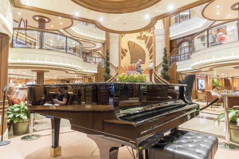 Grand Foyer and baby Grand piano MS Queen Elizabeth. MS Queen Elizabeth is a cruise ship of the Vista class operated by the Cunard Line. The design is modified royalty free stock photos