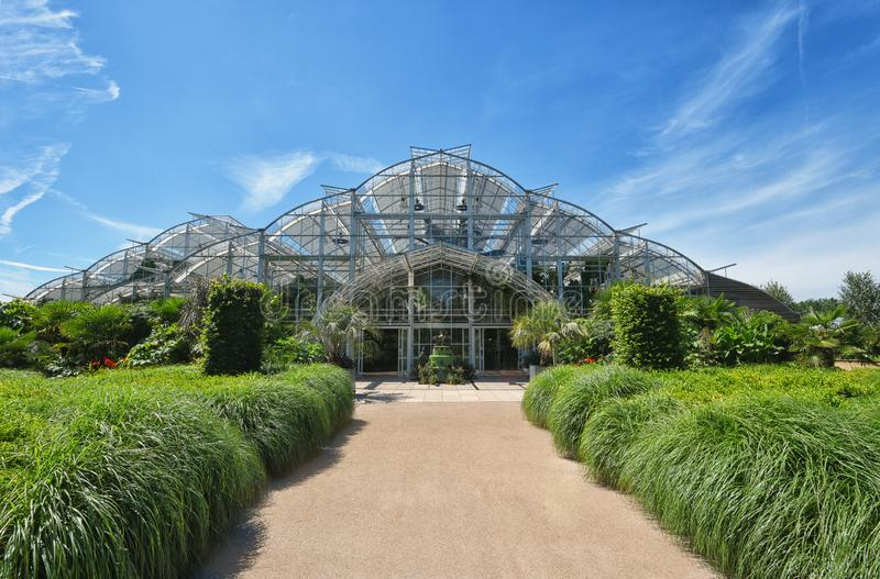 The Grand glasshouse, Wisley, Surrey. The Grand glasshouse on a sunny Summer day. Opened in 2007 and designed by architect Peter van der Toorn Vrijthoff, it has royalty free stock photos