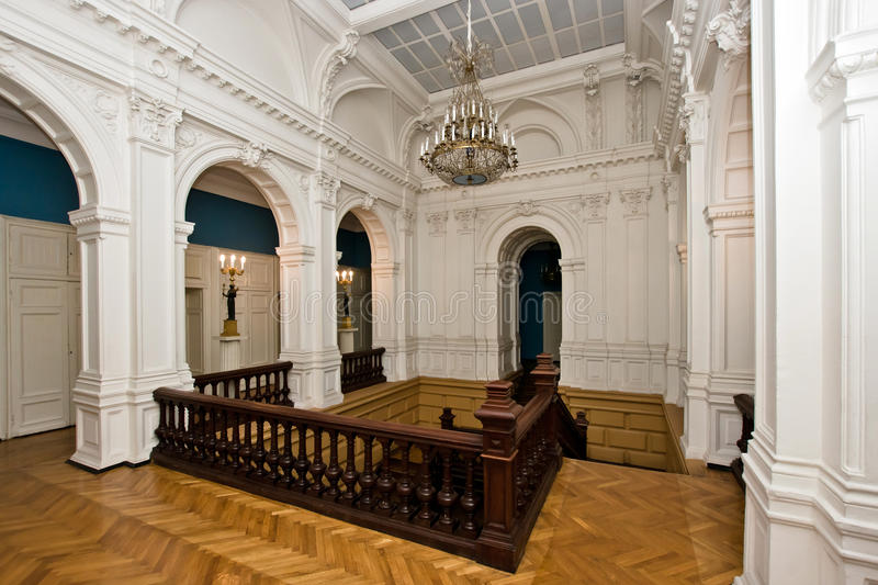 Grand hall in old majestic palace. With oak staircase royalty free stock photos