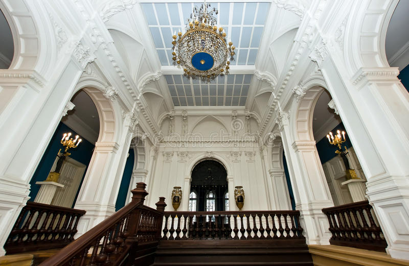 Grand hall in old majestic palace. With oak staircase stock photos