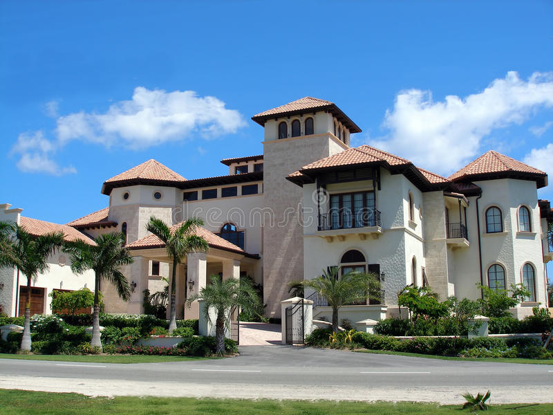 Grand home on Grand Cayman. Grand and imposing beachfront home on the Caribbean island of Grand Cayman. This enormous mansion is the newest and most luxurious royalty free stock images