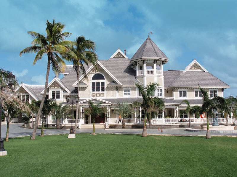 Grand home on Grand Cayman. Grand and imposing beachfront home on the Caribbean island of Grand Cayman royalty free stock photography