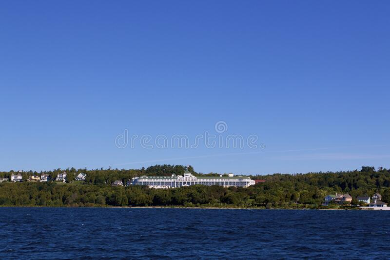 Grand Hotel   814079. Historic Grand Hotel all-inclusive coastal resort under blue sky on shore of Mackinac Island  viewed from Lake Huron   814079 royalty free stock photos