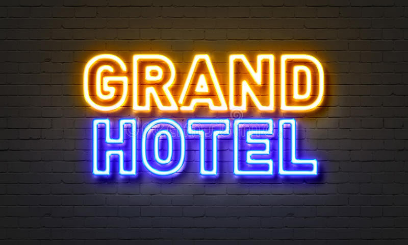 Grand hotel neon sign on brick wall background. stock illustration