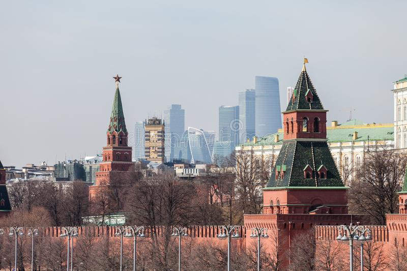 Grand Kremlin Palace Walls and Towers and modern Moscow International Business Center MIBC skyscrapers at Russia Moscow City. MOSCOW, RUSSIA - APRIL 5, 2018 royalty free stock photography