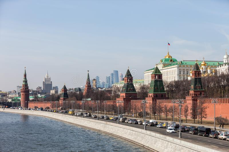 Grand Kremlin Palace Walls and Towers and modern Moscow International Business Center MIBC skyscrapers at Russia Moscow City. MOSCOW, RUSSIA - APRIL 5, 2018 royalty free stock photo