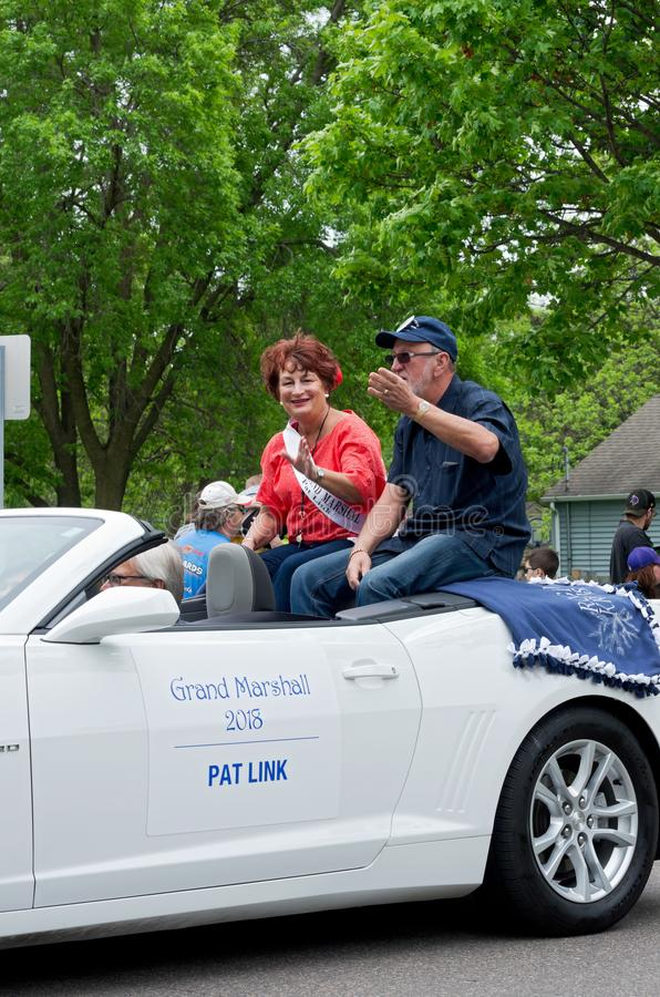 Grand Marshall Link Waves to Crowd royalty free stock photo