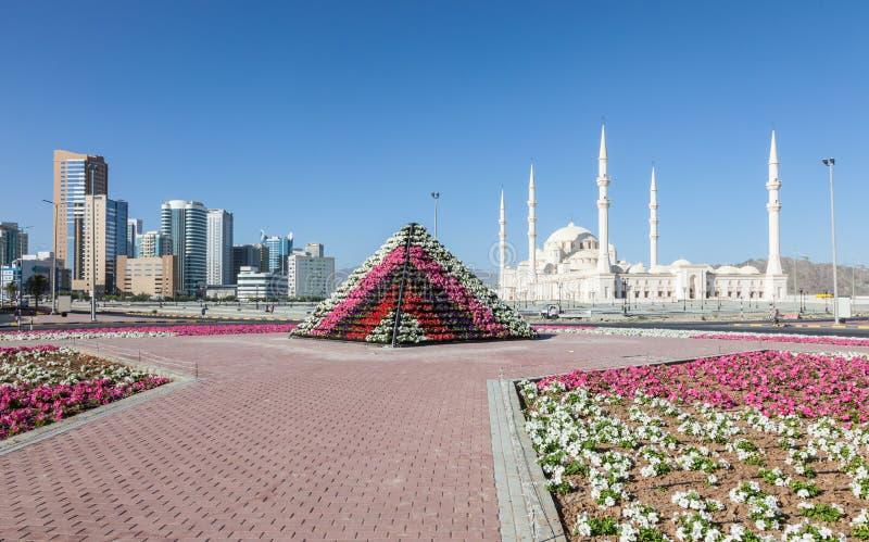Grand Mosque in Fujairah, United Arab Emirates. Flower pyramid and the Grand Mosque in Fujairah, United Arab Emirates stock photos