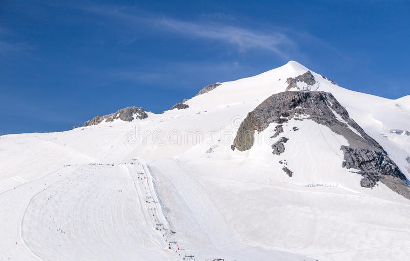 Grand Motte. Glacier, chair lift and the surrounding mountains in summer. Tignes, French Alps stock photography