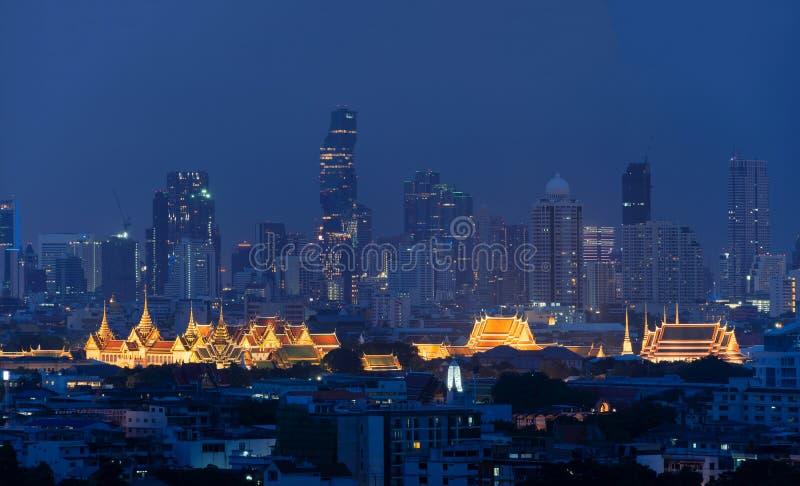 Grand Palace, Wat Pho, and skyscraper buildings. Bangkok. Downtown area at night, Thailand royalty free stock image