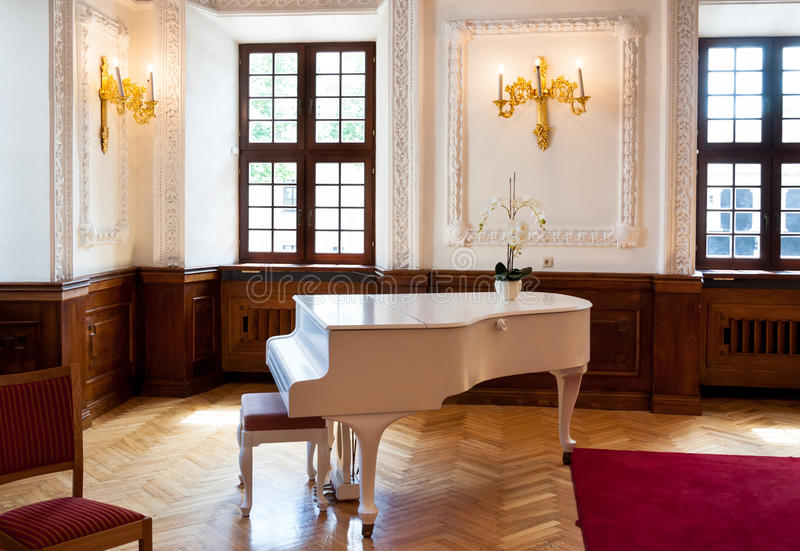 Grand piano in ballroom hall stock images