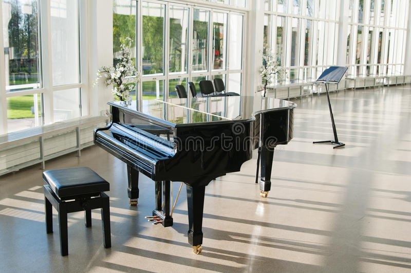 Grand piano in the hall stock images