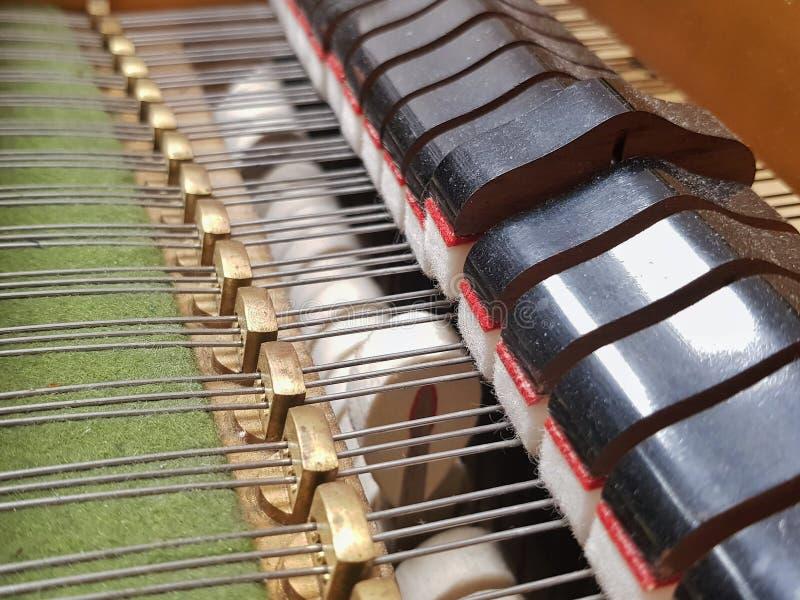 Grand piano inside - hammer mechanism royalty free stock photo